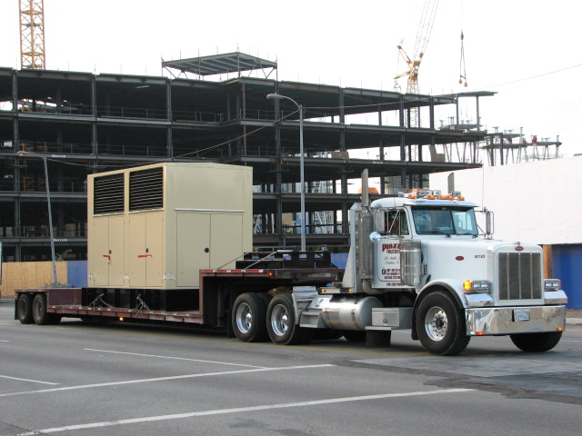 A double dropdeck flatbed trailer