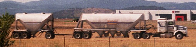 A rocky mountain double configuration with two dry bulk trailers