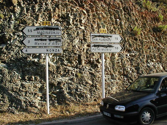 Bilingual road-signs, with French names crossed out