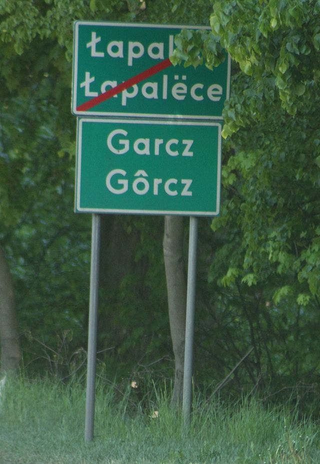 Two bilingual signs in Garcz in Kashubia with the Polish name above and the Kashubian name below