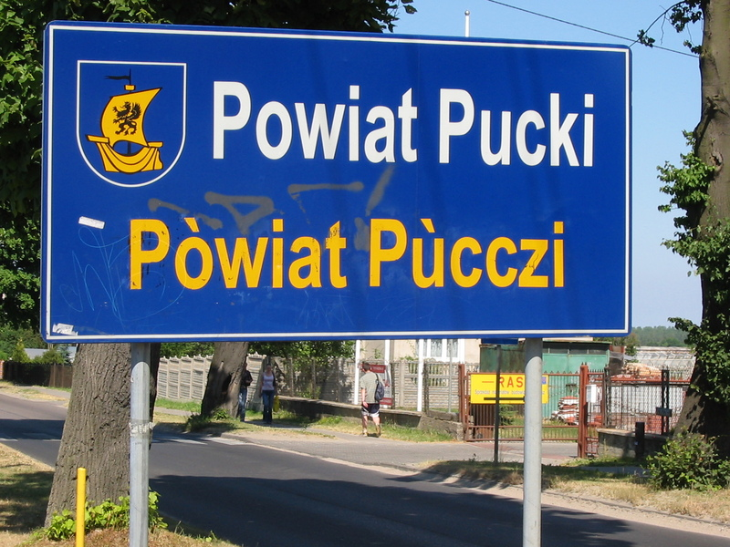 Bilingual sign in Polish and Kashubian in Pogorze, Puck County , Poland, on road from Gdynia to Rewa