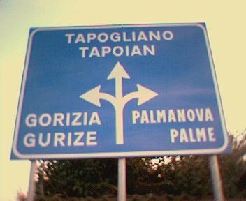 Road sign in Italian and Friulian