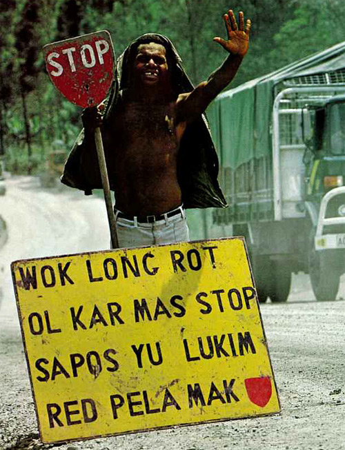 Sign in common use in the 1980s giving a warning in Tok Pisin