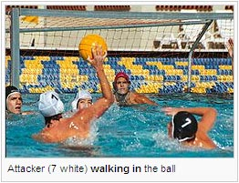 Attacker (7 white) walking in the ball