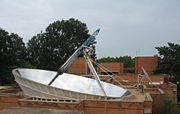 The Solar Bowl in Auroville, India, concentrates sunlight on a movable receiver to produce steam for cooking