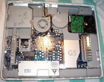 "The internals of the original 20"" iMac G5. Many hardware components can be seen"