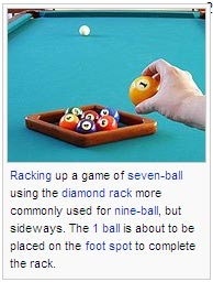 Racking up a game of seven-ball using the diamond rack more commonly used for nine-ball