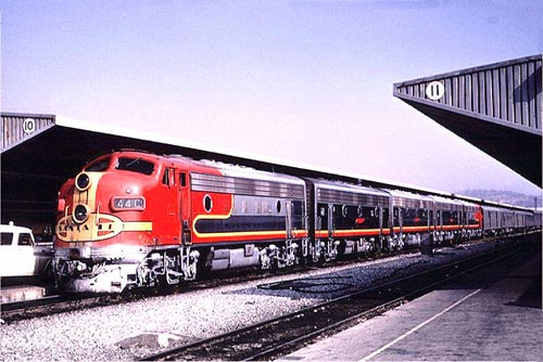 The combined Super Chief/El Capitan passenger train at Los Angeles Union Passenger Terminal in 1966 shows the red and silver warbonnet livery