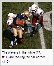The players in the white (#7, #11) are tackling the ball carrier (#10)